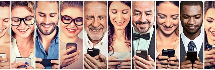 Men and Women looking at their smart phones. Are they monitoring their TMJ?